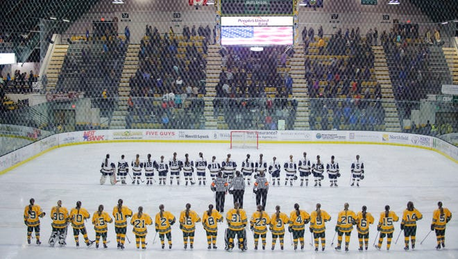 The teams listen to the National Anthem during the Vermont state division I girls hockey championship game between the Essex Hornets and the BFA St. Albans Comets at Gutterson Field House on Monday night March 12, 2018 in Burlington.