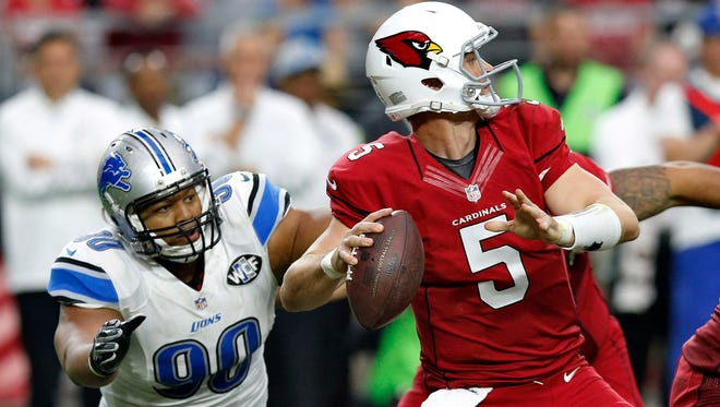Arizona Cardinals quarterback Drew Stanton looks to pass under pressure from Detroit Lions defensive tackle Ndamukong Suh (90) during the first half of an NFL football game, Sunday, Nov. 16, 2014, in Glendale, Ariz.