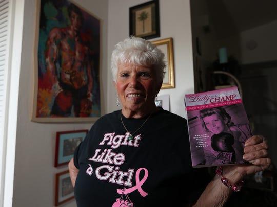 Cape Coral resident Carol Polis displays a copy of