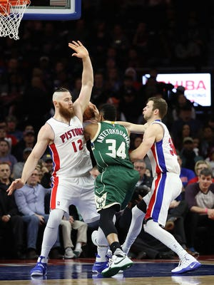 Dec 28, 2016; Auburn Hills, MI, USA; Milwaukee Bucks forward Giannis Antetokounmpo (34) drives the ball to the basket as Detroit Pistons center Aron Baynes (12) defends during the first quarter of the game at The Palace of Auburn Hills.