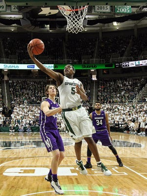 Michigan State Spartans guard Cassius Winston drives to the basket against Northwestern in the first half of MSU's 61-52 win over Northwestern on Dec. 30, 2016 at Breslin Center.