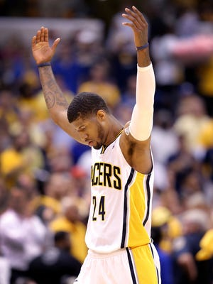Indiana Pacers play the Atlanta Hawks in the second game of their Eastern Conference first round game Tuesday, April 22, 2014, evening at Banker Life Fieldhouse. Pacers forward Paul George celebrates during a timeout.