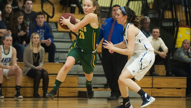 BFA's Lilly McAllister (20) drives to the hoop during the girls basketball playoff game Tuesday.