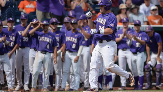 Jun 24, 2017; Omaha, NE, USA; LSU Tigers outfielder Beau Jordan (24) approaches home plate after hitting a home run in the sixth inning against the Oregon State Beavers at TD Ameritrade Park Omaha. Mandatory Credit: Steven Branscombe-USA TODAY Sports