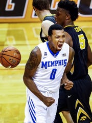 University of Memphis forward K.J. Lawson celebrates