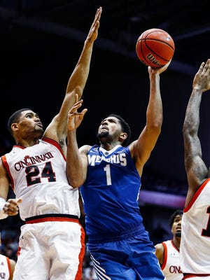 University of Memphis forward Dedric Lawson (middle) remains a hot topic among Tiger fans.