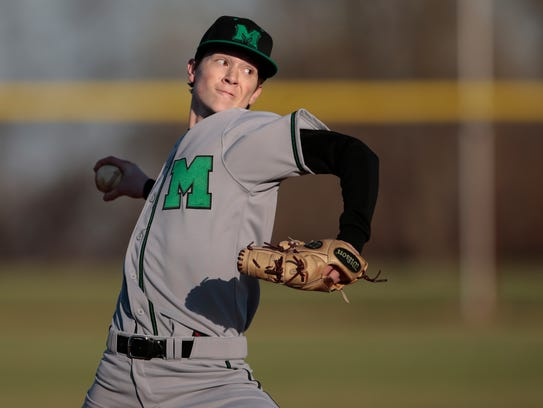 Mason pitcher Will Pfennig (3) delivers to the plate