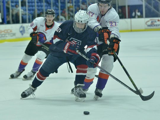 Fighting for possession of the puck Friday night at