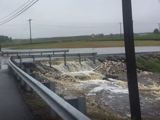 Water rushes off the road at the intersection of Rt.354 and Porters Crossing in Worcester County.
