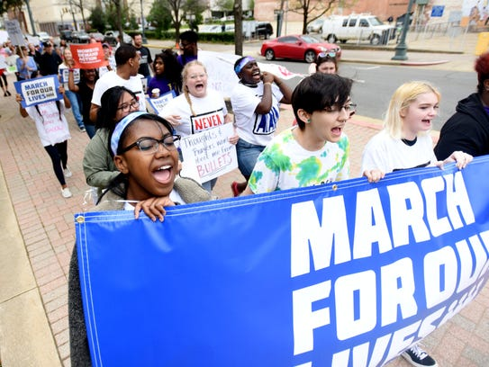 (Left to right) Tifphany McClinton, Ashford McLain, Allison Huffy and MauÕTisse Jackson lead the march during the March For Our Lives event Saturday, March 24, 2018, at the Caddo Parish Courthouse in Shreveport, Louisiana.
