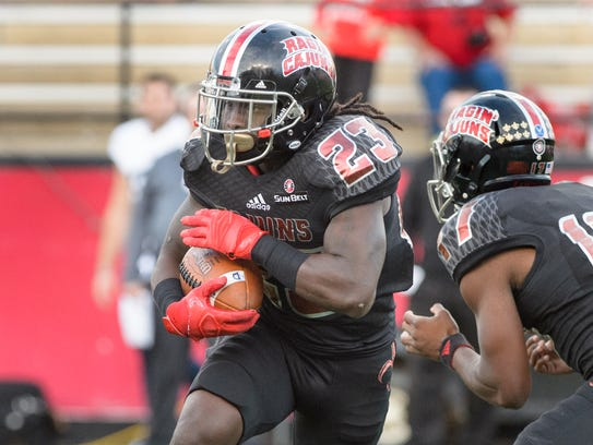 Cajuns runningback Darius Hoggins runs the ball as