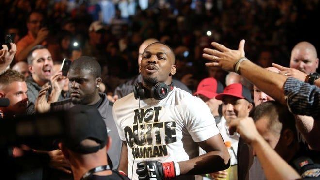 Jon Jones enters the octagon in September 2013 before his fight against Alexander Gustafsson (not pictured) during their Light Heavyweight Championship bout at UFC 165 at the Air Canada Centre.