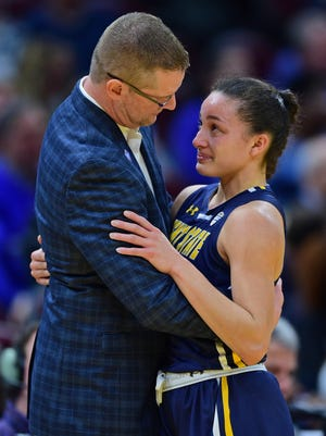 Kent State head coach Todd Starkey is pictured speaking with Alexa Golden during the final moments of her last game as a Golden Flashes player in March of 2018. Starkey has welcomed Golden, now an assistant coach for the Flashes, and his current players back to campus over the past couple of weeks. They have not all been in the same town at the same time since last March, when the remainder of the 2019-20 season was canceled due to COVID-19 issues and concerns.