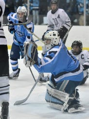 Long hours training and practicing enable Livonia Stevenson's Will Tragge to make the toughest saves look easy, such as this one against Plymouth in the recent Division 2 pre-regional.
