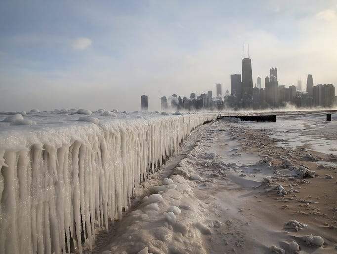 Ice builds up along Lake Michigan at North Avenue Beach