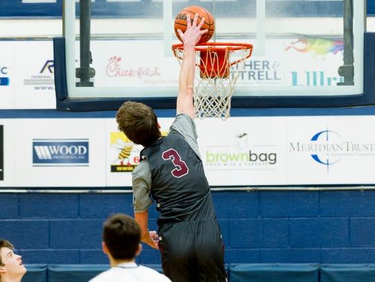 Bearden's Drew Pember (3) dunks against Farragut last season.