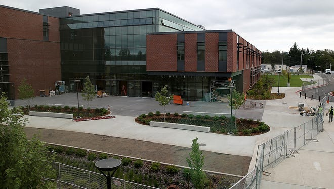 Olympic College's new building won't open in time for the beginning of fall quarter, as had been planned. The college now expects to have the building open in time for winter quarter, which begins Jan. 2.