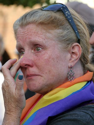 Maureen Porette of Stony Point is overcome with emotion during a vigil in Nyack for the victims in the Orlando mass shooting.