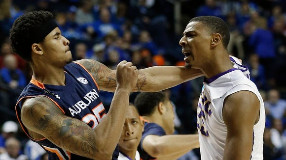 Auburn forward Jordon Granger (25) hits LSU guard Tim