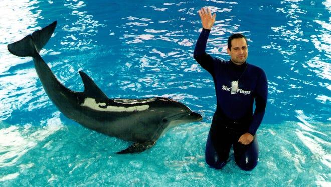 Nico Maragos and Sadie the dolphin at SeaWorld Ohio.
