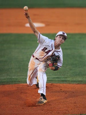 Westside's Trevor Scarborough pitches to Riverside during the top of the first inning of the Class AAAAA District II championship at Westside High School in Anderson on Monday.