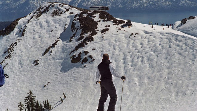 A skier contemplates Siberia Bowl at Squaw Valley.