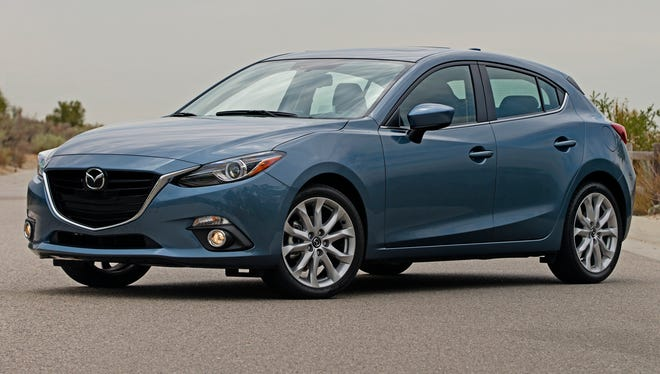 This 2014 Mazda3 was one of the models cited by Kelley Blue Book in naming Mazda the mainstream brand winner in its latest annual awards for lowest cost of ownership for the first five years.