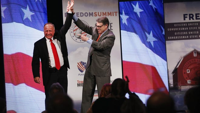Rep. Steve King, left, helps host last month's Iowa Freedom Summit, which gathers potential Republican presidential candidates, such as former Texas governor Rick Perry.