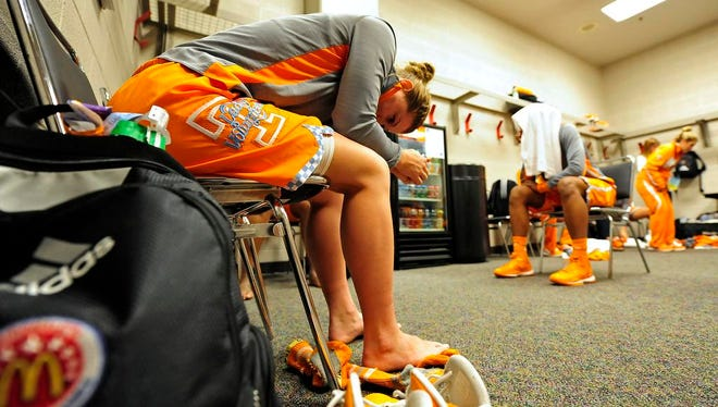 Tennessee guard Alexa Middleton, left, hangs her head as forward Bashaara Graves covers her face with a towel in the locker room after a 58-48 loss to Maryland in the NCAA Tournament on Monday in Spokane, Wash.