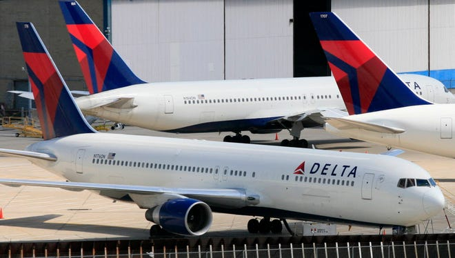 Delta Air Lines jets are parked at John F. Kennedy International Airport in New York on April 20, 2010.