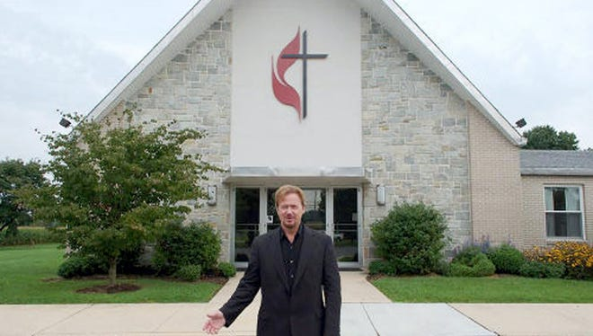 The Rev. Frank Schaefer stands outside Zion United Methodist Church of Iona in South Lebanon Township, where he served for 20 years. Schaefer was defrocked by the Methodist Church for presiding over his son's gay marriage in 2007 but was reinstated.