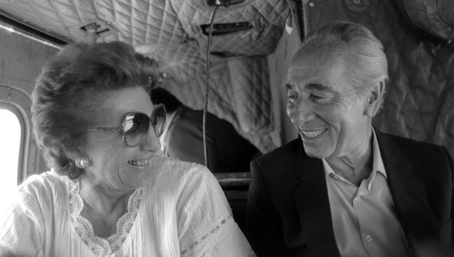 A handout picture dated May 7, 1985, provided by the Israeli Government Press Office in 2011 shows veteran Israeli statesman Shimon Peres (R) with his wife Sonya (L) as they fly together in a helicopter over northern Israel to Kibbutz Alumot, a community that they both helped to found. According to Israeli media, Peres died on Tuesday in Israel at the age of 93.