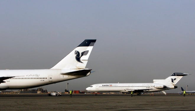 Two passenger planes of Iran's national air carrier, Iran Air, are parked March 2, 2008, at the Mehrabad Airport in Tehran, Iran.
