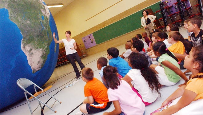 In this file photo, Sonya Robbins of Earth Adventure points out geographical features to students of Bloomfield's Fairview Elementary School.