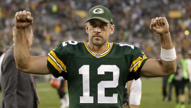 Green Bay Packers quarterback Aaron Rodgers (12) celebrates an overtime victory against the Cincinnati Bengals Sunday, September 24, 2017, at Lambeau Field in Green Bay, Wis.