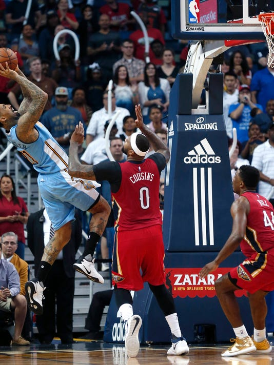 Denver Nuggets forward Wilson Chandler shoots over New Orleans Pelicans forward DeMarcus Cousins (0) in the second half of an NBA basketball game in New Orleans, Tuesday, April 4, 2017. The Nuggets won 134-131. (AP Photo/Gerald Herbert)