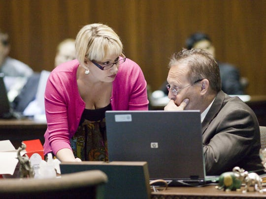 Kyrsten Sinema talks with Andy Biggs in the House of Representatives in 2009.