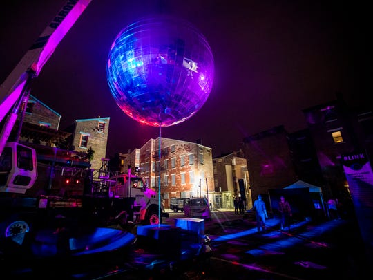The world's largest mobile disco ball spins on Pleasant Street near Findlay Market. It hails from Louisville, Kentucky.