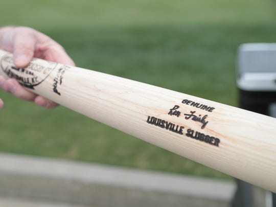 Ron Fairly points out the details on his custom Louisville Slugger bat. The long time resident of Indian Wells recently completed his first person memoir about his life as a major league baseball player and broadcaster, Wednesday, March 7, 2018.