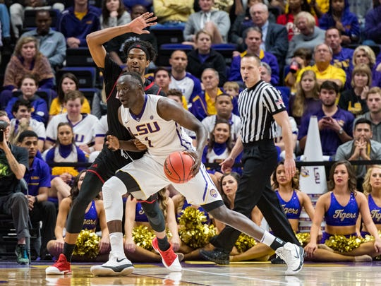 LSU's Duop Reath, shown here working against JaKeenan Gant, had 26 points as the Tigers' dominate inside during an 84-76 NIT win over UL on Wednesday night.