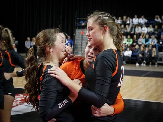West Des Moines Valley senior Taylor Gion, right, comforts