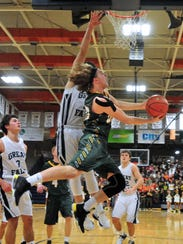 CMR's Garrison Rothwell attempts a reverse layup during