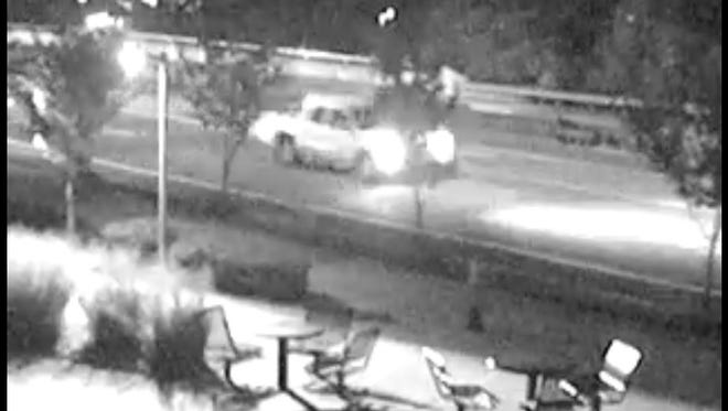 Surveillance image of pickup involved in fatal hit and run on Charlotte Avenue.