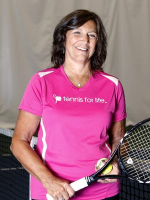 Breast cancer survivor Andrea Flatow runs the Rockland chapter of Tennis for Life, a group that offers free tennis instruction to breast cancer survivors at Match Point Tennis Club in Orangeburg.