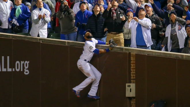 Oct 30, 2016; Chicago, IL, USA; Chicago Cubs right fielder Jason Heyward (22) makes a catch against Cleveland Indians starting pitcher Trevor Bauer (not pictured) for an out during the third inning in game five of the 2016 World Series at Wrigley Field. Mandatory Credit: Jerry Lai-USA TODAY Sports