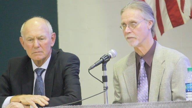 Richard Boss and James T. Baker speak about city issues on Thursday.