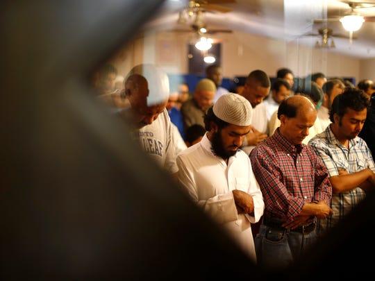Muslim men pray at the Al-Furqan Mosque during Ramadan