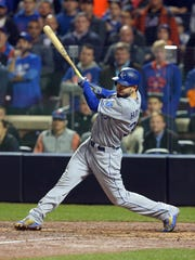 Nov 1, 2015; New York City, NY, USA; Kansas City Royals first baseman Eric Hosmer hits a RBI double against the New York Mets in the 9th inning in game five of the World Series at Citi Field. Mandatory Credit: Brad Penner-USA TODAY Sports