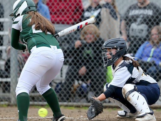 Bainbridge softball catcher Maddie Loverich snags a low pitch from batter Ashley Howell of Port Angeles at the 2017 senior All-Star baseball game at the Kitsap County Fairgrounds on Tuesday. The game was called due to bad weather.