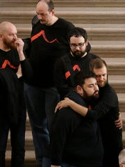 Members of the San Francisco Gay Men's Chorus hug after performing at a meeting at City Hall in San Francisco by city leaders and community activists to reaffirm the city's commitment to being a sanctuary city in response to Donald Trump's support of deportations and other measures against immigrants Monday, Nov. 14, 2016.